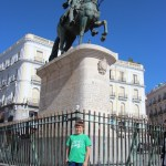 Spencer by statue at Puerta del Sol