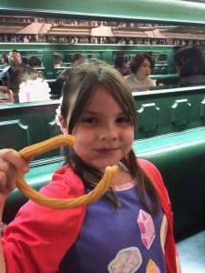 Meg likes her churro shaped like a C