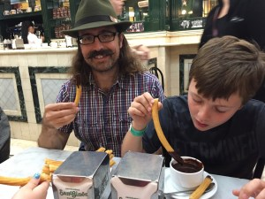 Spencer and Rob enjoying churros dipped in hot chocolate