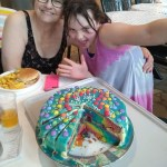 Meg and Grandma showing off the rainbow cake