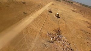 Bulldozers with chains clearing vegetation in Queensland.