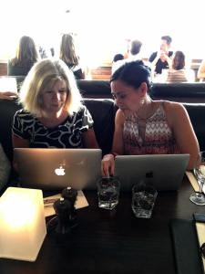 This is an image of website developer Sally Burford and Linda Pang during a meeting