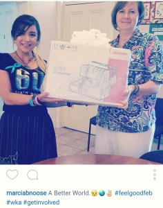 This is a photo of Barbwire Noose company presenting a Janome sewing machine to Mount Gambier Migration Resource Centre.