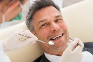 men at dentist