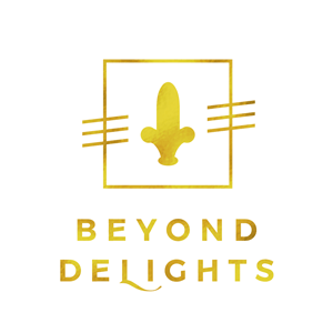 A gold logo for the company Beyond Delights