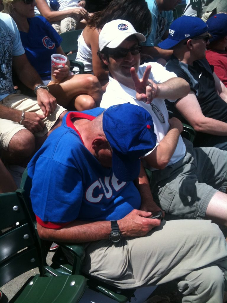 Dad Asleep at a Cubs Game with Daniel's Support