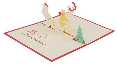 Postal de navidad hecha a mano con reno en un trineo