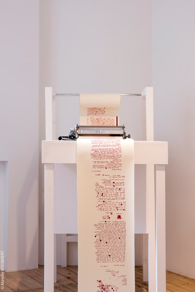 Nandita Kumar   Detail: eMotiVe sOuNDs of the eLEctRic wRiTEr  (project commissioned by the Jeu du Paume 2013-…)  Paper scroll, Machine, ink, wood, handwritten letters, video and sound installation   Photographic credits: Mireille Roobaert