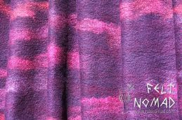 A nuno felted fine merino scarf in purple berry colours on a hand-dyed silk georgette fabric