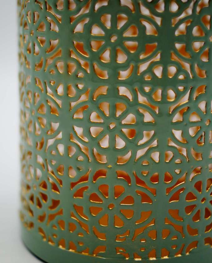 Lantern made of metal in light pastel green color