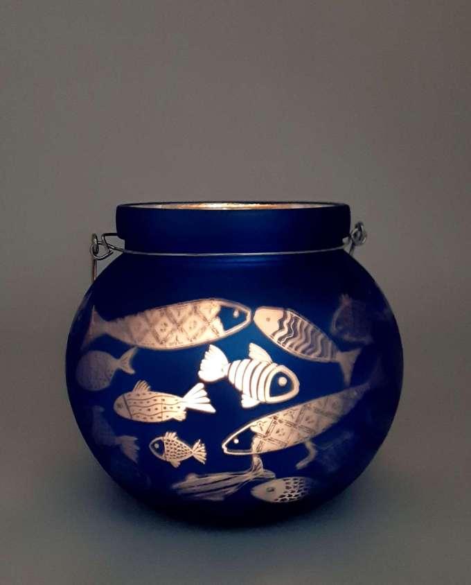 Roundblue lantern for votive with fish pattern