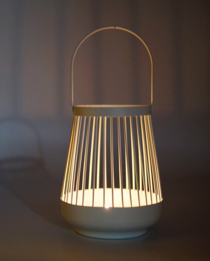 Lantern made of metal in bright white color lighted