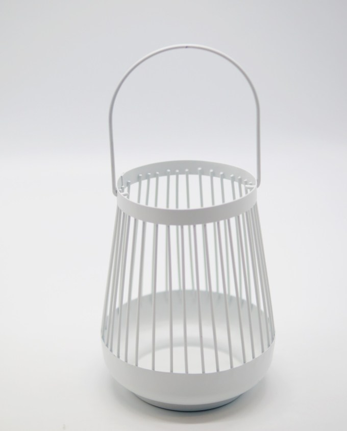 Lantern made of metal in bright white color.