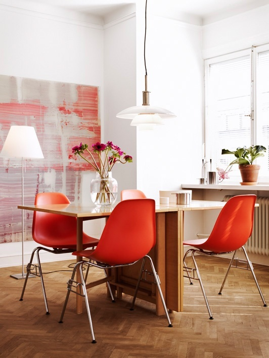 Home Design Dining Room with Modern Dining Table and Orange Dining Chairs and White Walls with Orange Abstract Art  and Plant Decor