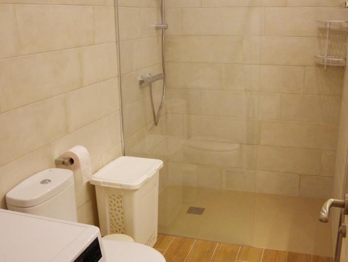 Bathroom 1 with washing machine.