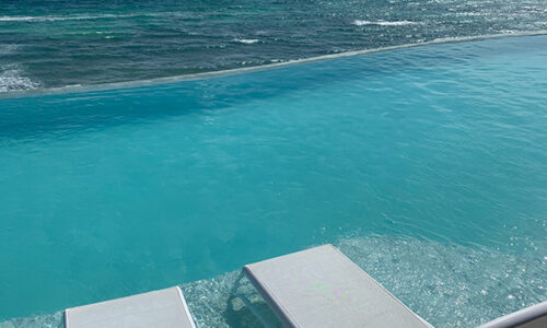 chairs by infinity pool