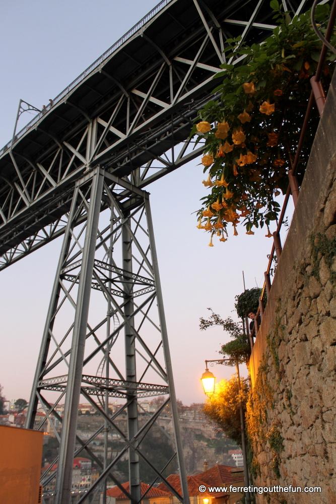 Walking beneath the Ponte Luis I Bridge in Porto