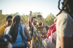 man-in-colorful-shirt-dancing-in-crowd-at-festival