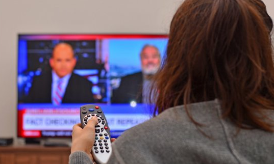 watching news