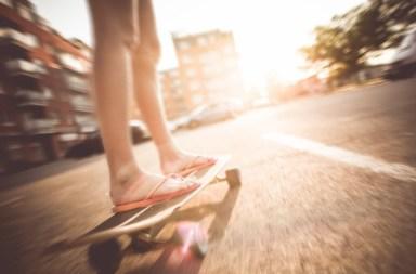 Girl on skateboard on road