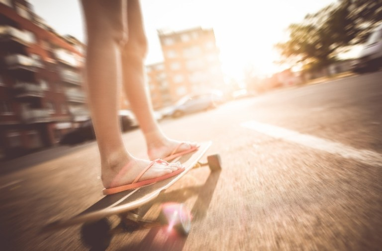 Girl on skateboard on road
