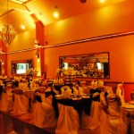 Herreras Reception Hall Amber LED Uplights Full Side Wall From Entrance
