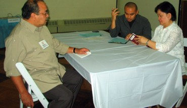 Attorney Merit Salud (left) assisting a Filipino woman who has questions about immigration - Photo: Cristina DC Pastor