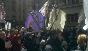 Marchers commemorated the 100th anniversary of the Triangle Shirtwaist Factory Fire