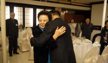 John Liu gets a hug from a longtime supporter at a recent fundraiser
