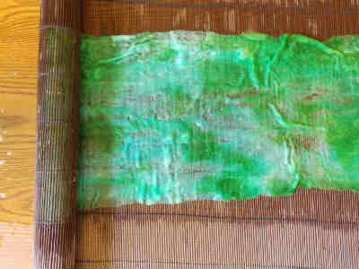 Rolling the felt wool scarf in a matchstick blind or bubble wrap