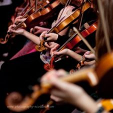 Students playing fiddles