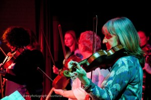 Fiddlers playing at a ceilidh