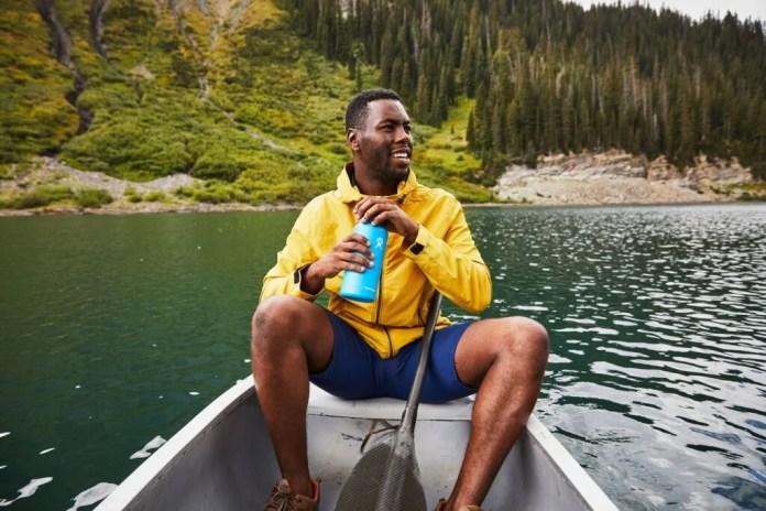Man using Hydro Flask reusable water bottle