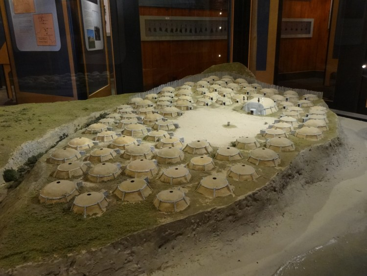 A diorama of On-a-Slant village with earth lodges