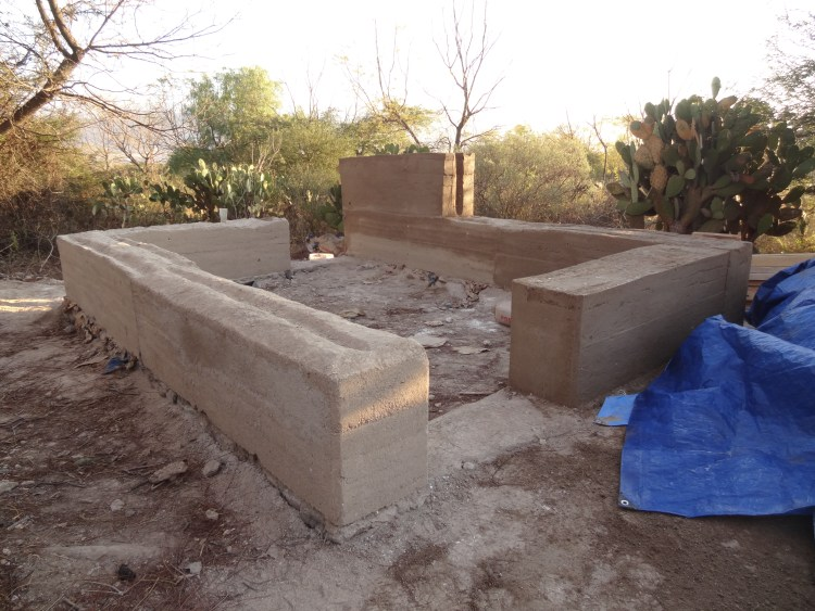 Unfinished rammed earth cabin