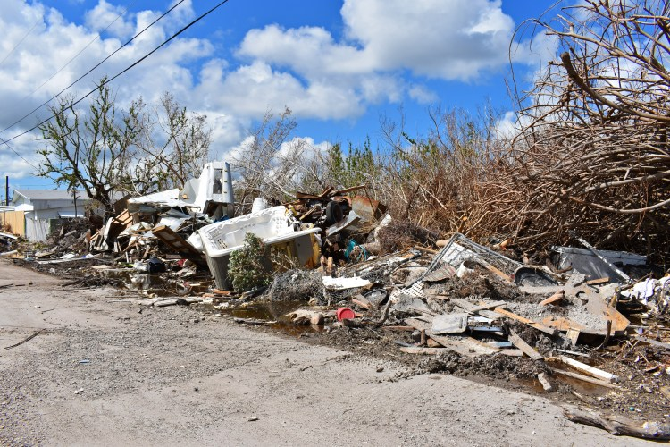 Debris by the road in Big Pine Key after Hurricane Irma