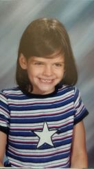 1st grade. Yes, I still have that evil grin.