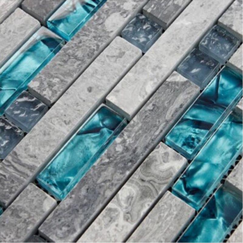 teal blue glass tile backsplash gray marble strip random interlocking bathroom shower tiles