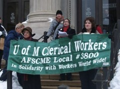 Union workers with AFSCME Local 3800 speaking and holding banners