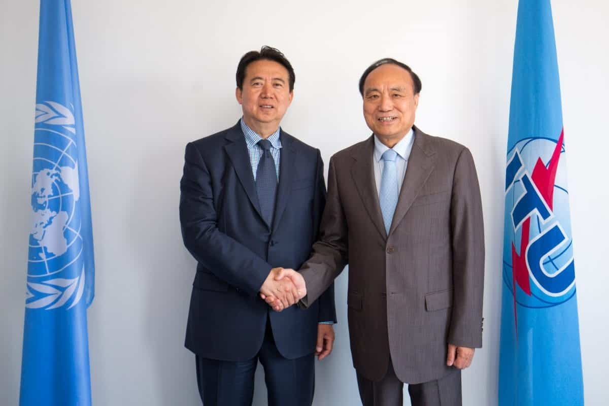Mr. Meng Hongwei, President Of INTERPOL Shacking Hands With Houlin Zhao, Secretary-General, ITU With Both Authorities' Flag