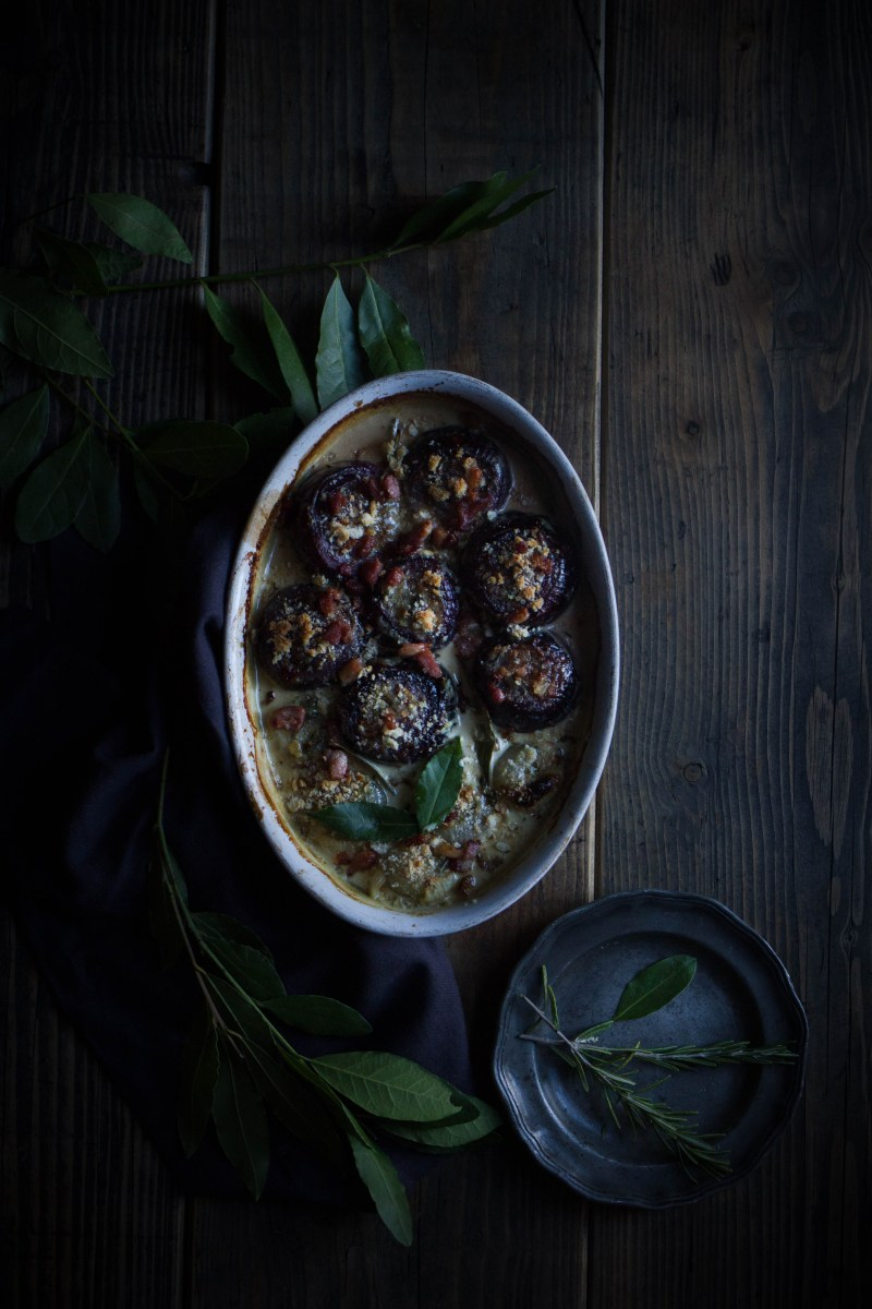 Baked onions with bacon and Stilton in a creamy mustard sauce