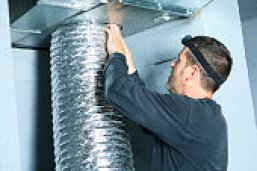 man doing duct cleaning