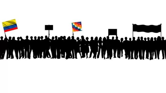 «En la atmósfera se percibe algo distinto, unas fuerzas vivas se están manifestando aquí y ahora y no se van a dispersar tan fácilmente. Lo escribo claro en la evidente incertidumbre, en medio de la inquietud y el dolor por quienes están más expuestos y ya han sido reprimidos, y de la esperanza viva por lo que aún puede pasar», escribe Laura Quintana sobre las protestas actuales en Colombia. Diseño hecho a partir de ilustración de OpenClipart-Vectors, de Pixabay, a la que hemos añadido las banderas de Colombia (izda.) y la wiphala, la indígena.