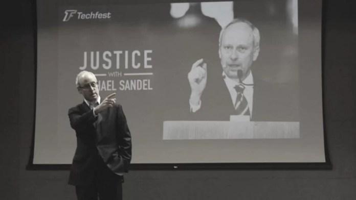 El filósofo estadounidense Michael Sandel en el Techfest de 2014. En este artículo, Magdalena Reyes Puig nos habla de la meritocracia a través de su último libro, La tiranía del Mérito. Imagen con licencia Attribution-ShareAlike 3.0 Unported (CC BY-SA 3.0).