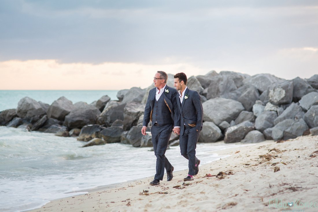 gay couple walking down the beach in key west florida