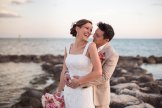 bride and groom posing on rocks at smathers beach in key west florida