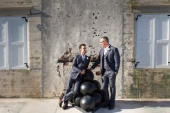 gay couple posing for their wedding photograph