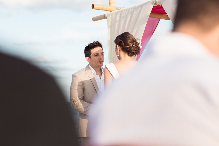 groom looking at his bride during beach ceremony