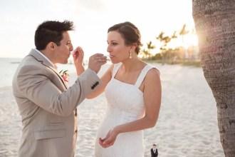 bride and groom eating their wedding cake