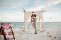 bride and groom kiss at the altar on smathers beach in key west florida